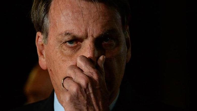 """35 ألف وفاة بكورونا بالبرازيل..والرئيس يهدد """"الصحة العالمية"""""""